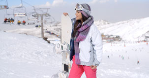 Young woman surveying the snow mountain slopes Stock Photo