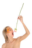 Young woman swallows of flower Stock Photo