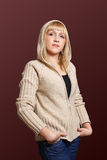 Young woman in sweater. With hood Royalty Free Stock Images