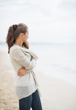 Young woman in sweater on beach looking into distance Royalty Free Stock Photos