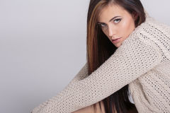 Young woman in the sweater Stock Images