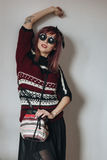 Young woman in sweater and skirt with glasses Royalty Free Stock Photo