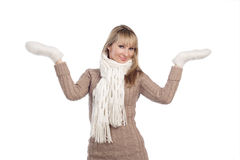 Young woman in sweater wollen mitten sweater. Portrait isolated on white background Stock Image