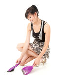 Young woman with sweep brush and dustpan Royalty Free Stock Photography