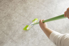 Sweeping with a broom Stock Photo