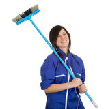 Young woman with sweeping brush Stock Photo