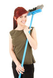 Young woman with sweeping brush Royalty Free Stock Photography