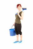 Young woman with sweeping brush and blue bucket Royalty Free Stock Photography