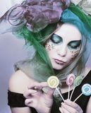 Young woman with sweets Stock Photography