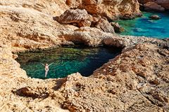 Young woman swim in Pissina of Koufonissi, Greece Royalty Free Stock Photo