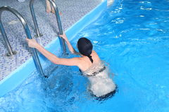 Young Woman swim in pool Royalty Free Stock Image