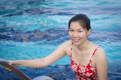Young woman swim in the pool royalty free stock image