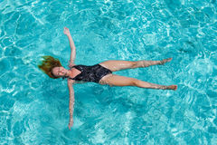 Young woman swiming in sea.Portrait in a sunny day. Young woman swiming in sea Royalty Free Stock Images
