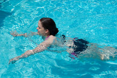 Young Woman Swimming royalty free stock images