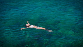 Young woman swimming in beautiful azure sea stock video footage