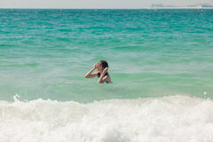 Young Woman Swimming In Ocean Stock Photography