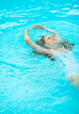 Young woman swimming in pool Royalty Free Stock Images