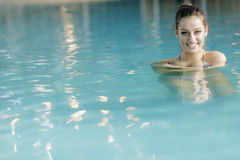 Young woman in swimming pool Royalty Free Stock Images
