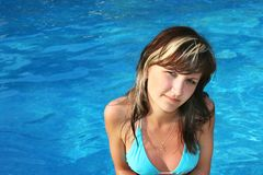 Young woman in swimming pool Stock Images