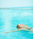 Young woman swimming in pool Royalty Free Stock Image