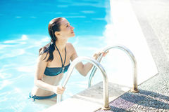 Young woman in the swimming pool Stock Photo