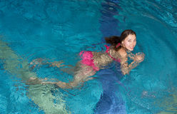 Young woman in a swimming pool Stock Image