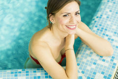 Young woman in the swimming pool Stock Images