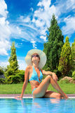 Young woman by the swimming pool Royalty Free Stock Images