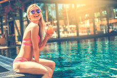 Young woman in the swimming pool rest Stock Images