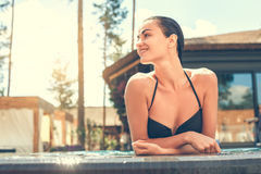 Young woman in the swimming pool rest Stock Photography