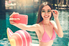 Young woman in the swimming pool rest Royalty Free Stock Image