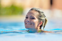 Young woman swimming in the pool Stock Image