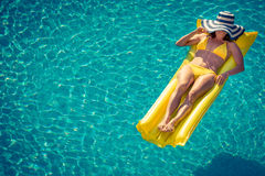 Young woman in swimming pool Royalty Free Stock Photos