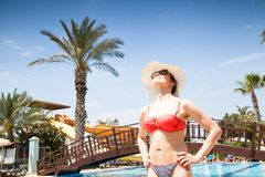 Young woman at the swimming pool Stock Photography