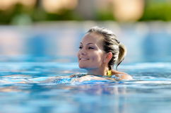 Young woman swimming in the pool Royalty Free Stock Photography