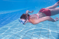 young woman swimming underwater in a pool Stock Images