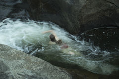 Young woman swimming upstream, against current, Sugar River, New Royalty Free Stock Photos