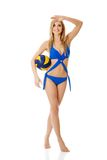 Young woman in swimsuit with a ball Stock Images