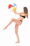 Young woman in swimsuit with beach ball Stock Photography