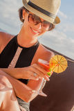 Young woman in swimsuit with cocktail on the beach in trop Royalty Free Stock Photography