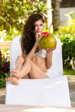 Young woman in swimsuit with coconut cocktail stock photos