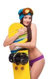 Young woman in swimsuit hugging snowboard Stock Photo