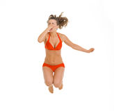 Young woman in swimsuit jumping in water Royalty Free Stock Images