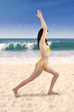 Young woman in swimsuit meditating Stock Image