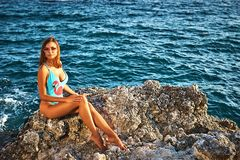 Young woman in a swimsuit near the sea Royalty Free Stock Images