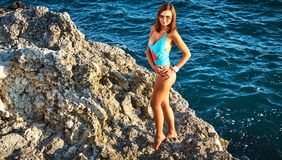 Young woman in a swimsuit near the sea Royalty Free Stock Photography