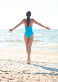 Young woman in swimsuit posing on beach Stock Photos