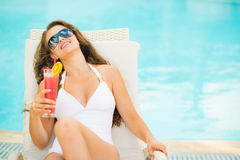 Young woman in swimsuit relaxing with cocktail Royalty Free Stock Image