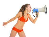 Young woman in swimsuit shouting through megaphone Stock Photos