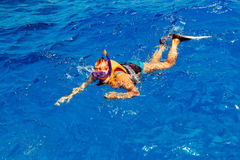 Young woman in swimsuit snorkeling Stock Images